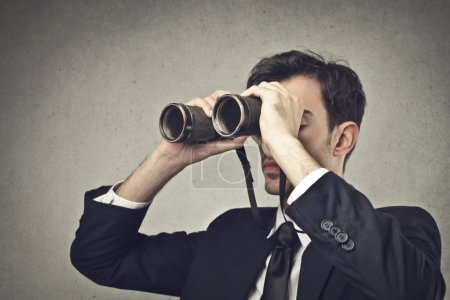Photo for Businessman looking through a binoculars - Royalty Free Image