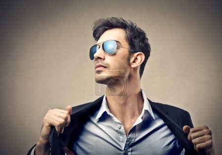 Photo for Man wearing sunglasses and smart cloths - Royalty Free Image