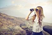 Beautiful woman with binoculars