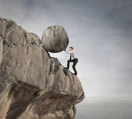 Businessman holding a rock
