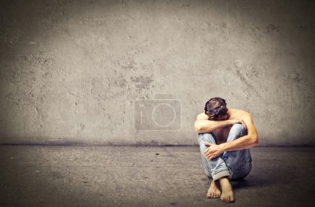 Photo for Desperate hopeless sad man crying on himself - Royalty Free Image
