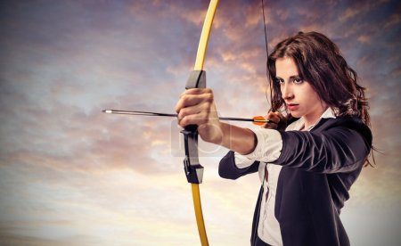Photo for Business woman aiming with bow and arrow - Royalty Free Image
