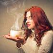 Woman holding a cup of tea...
