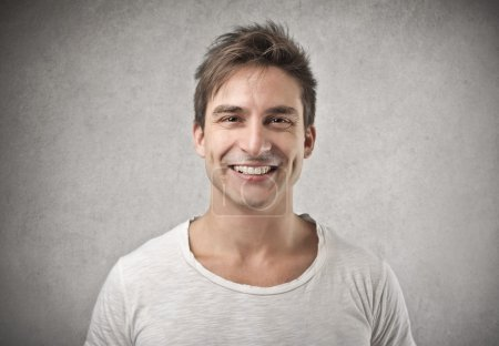 Photo for Handsome man smiling happily - Royalty Free Image