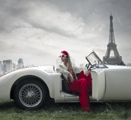 Fashion woman on a car