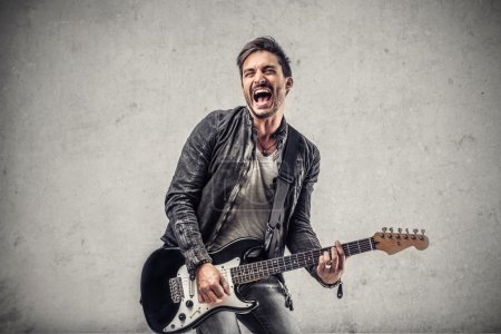 Photo for Musician intent to play his guitar - Royalty Free Image