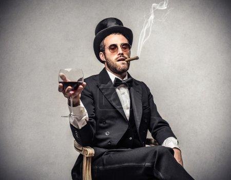 Rich man smoking a cigar