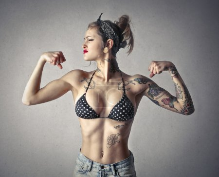 Strong woman with tattos