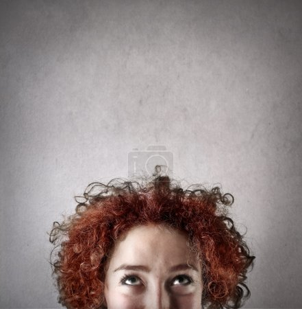Photo for Woman looking on the top and thinking - Royalty Free Image