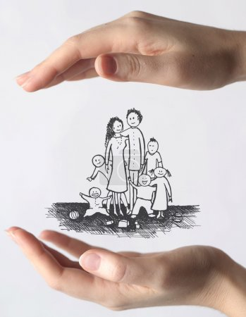 Photo for Hands protecting a drawn family - Royalty Free Image