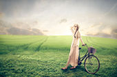Young vintage woman with a bike
