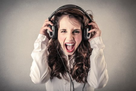 Screaming woman with headphones