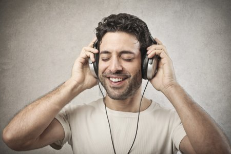 Handsome man listening to the music