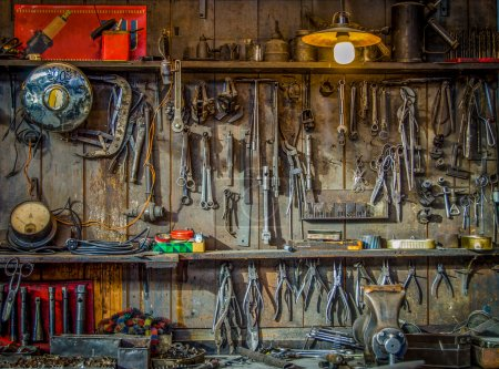 Photo for Vintage Tools Hanging On A Wall In A Tool Shed Or Workshop - Royalty Free Image