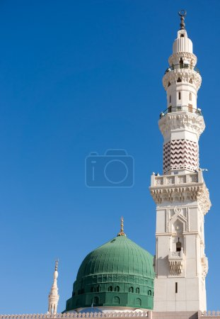 Towers of the Nabawi mosque againts blue sky. Naba...