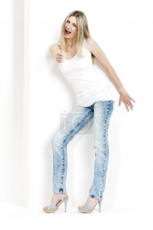 standing woman wearing jeans and summer shoes