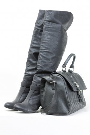 gray boots with a handbag