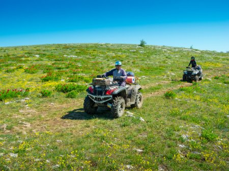 Couple ride on ATVs