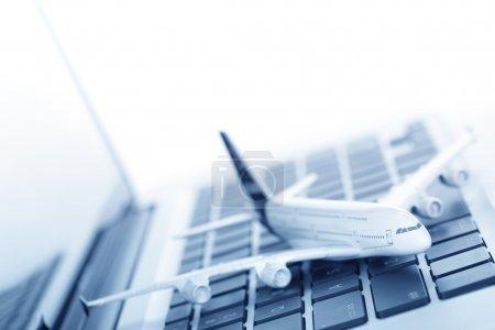Model plane on laptop keyboard