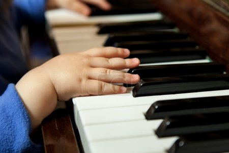 Baby hands playing piano