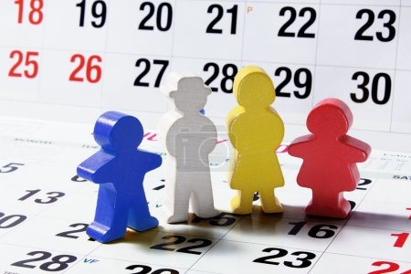Photo for Family Figures on Calendar Page - Royalty Free Image