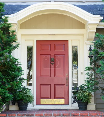 Photo for Magenta home door with arched top with two windows - Royalty Free Image