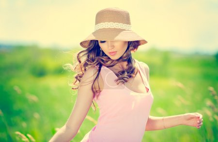 Photo for Beautiful happy woman in hat on summer meadow - Royalty Free Image