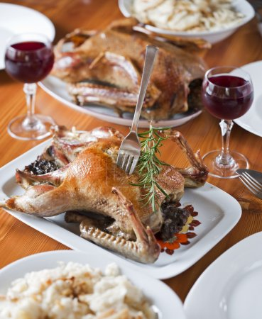 Photo for Roasted duck for holidays on the table close up - Royalty Free Image