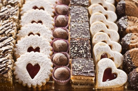 Photo for Assorted selection of biscuits in festive background - Royalty Free Image