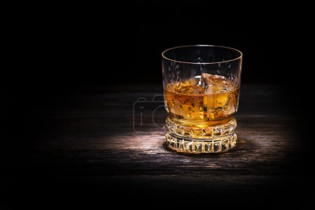 Photo for Glass of whiskey on wooden background close up - Royalty Free Image