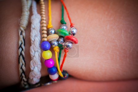 Collection colorful of bracelets on woman hand...