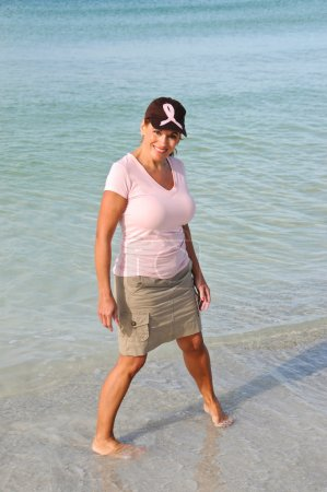 Attractive Woman on the Beach Wearing Pink Ribbon
