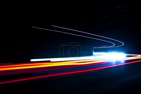 Car light trails. Art image. Long exposure photo taken in a tunn