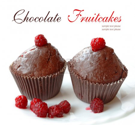 Photo for Stock Photo - Chocolate fruitcakes covered with raspberry on a white background - Royalty Free Image