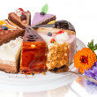 Different pieces of cake and flower. Isolated on w...