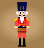 Cute red retro Nutcracker isolated on brown