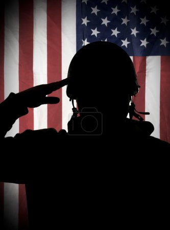 Photo for American (USA) patriot soldier saluting to USA flag - Royalty Free Image