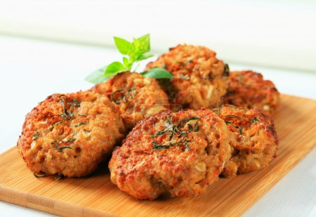 Fried vegetable burgers on cutting board...
