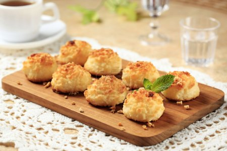 Photo for Coconut macaroons on cutting board - Royalty Free Image