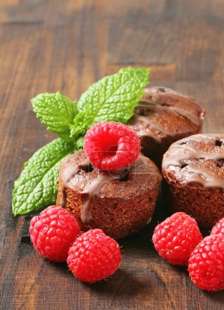 Photo for Mini chocolate cakes with raspberry filling - Royalty Free Image