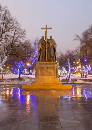 Saints Cyril and Methodius monument and trees illuminated to Christmas and New Year holidays at night in Moscow, Russia.