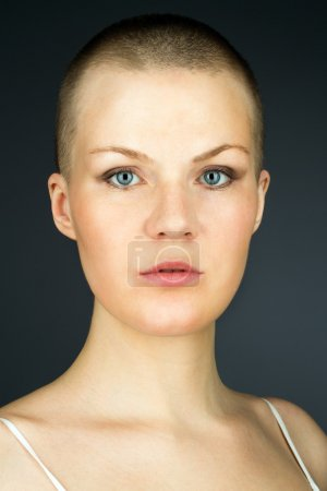 Woman with shaved hairstyle