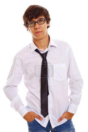 Serious teenager in black glasses