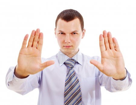Photo for Young serious businessman with open forward palms showing stop gesture. Mask included - Royalty Free Image
