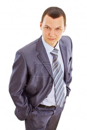 Serious confident young businessman in suit