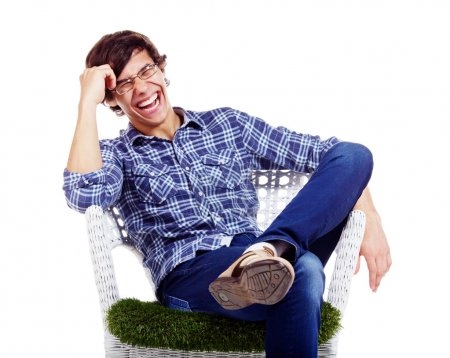 Relaxed guy laughing in armchair