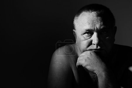 Photo for Dramatic close up portrait of depressed old man - Royalty Free Image