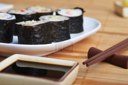Photo for Dish with fresh sushi rolls on bamboo napkin background - Royalty Free Image