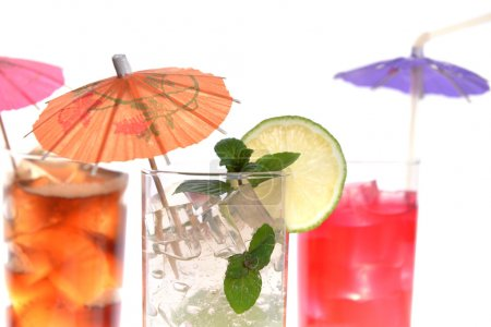 Photo for Cocktail in wineglasses with lime, mint and umbrella - Royalty Free Image