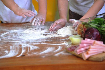 Photo for On kitchen table preparing dough - Royalty Free Image